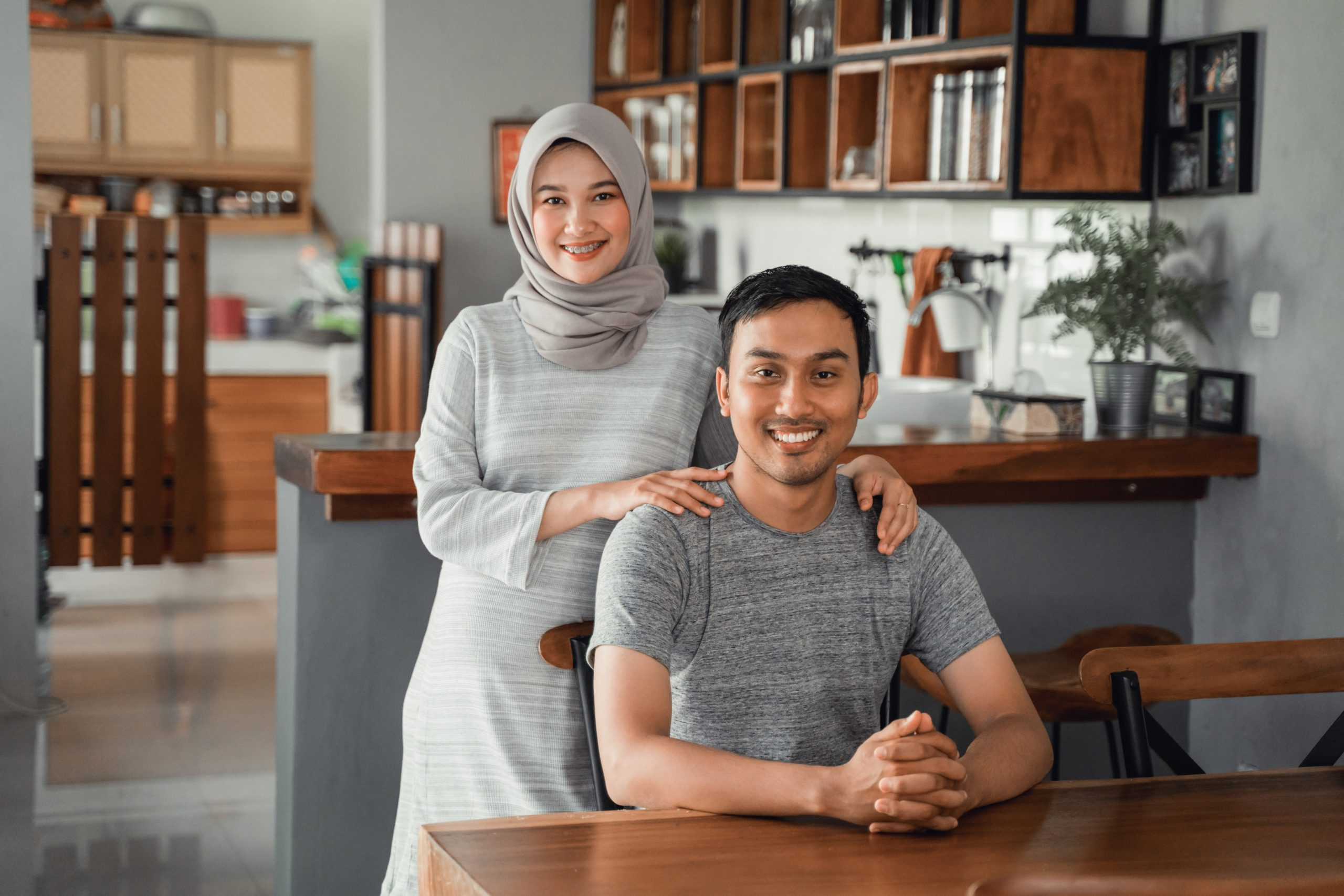 muslim-couple-sitting-dining-room-together-scaled-1.jpg